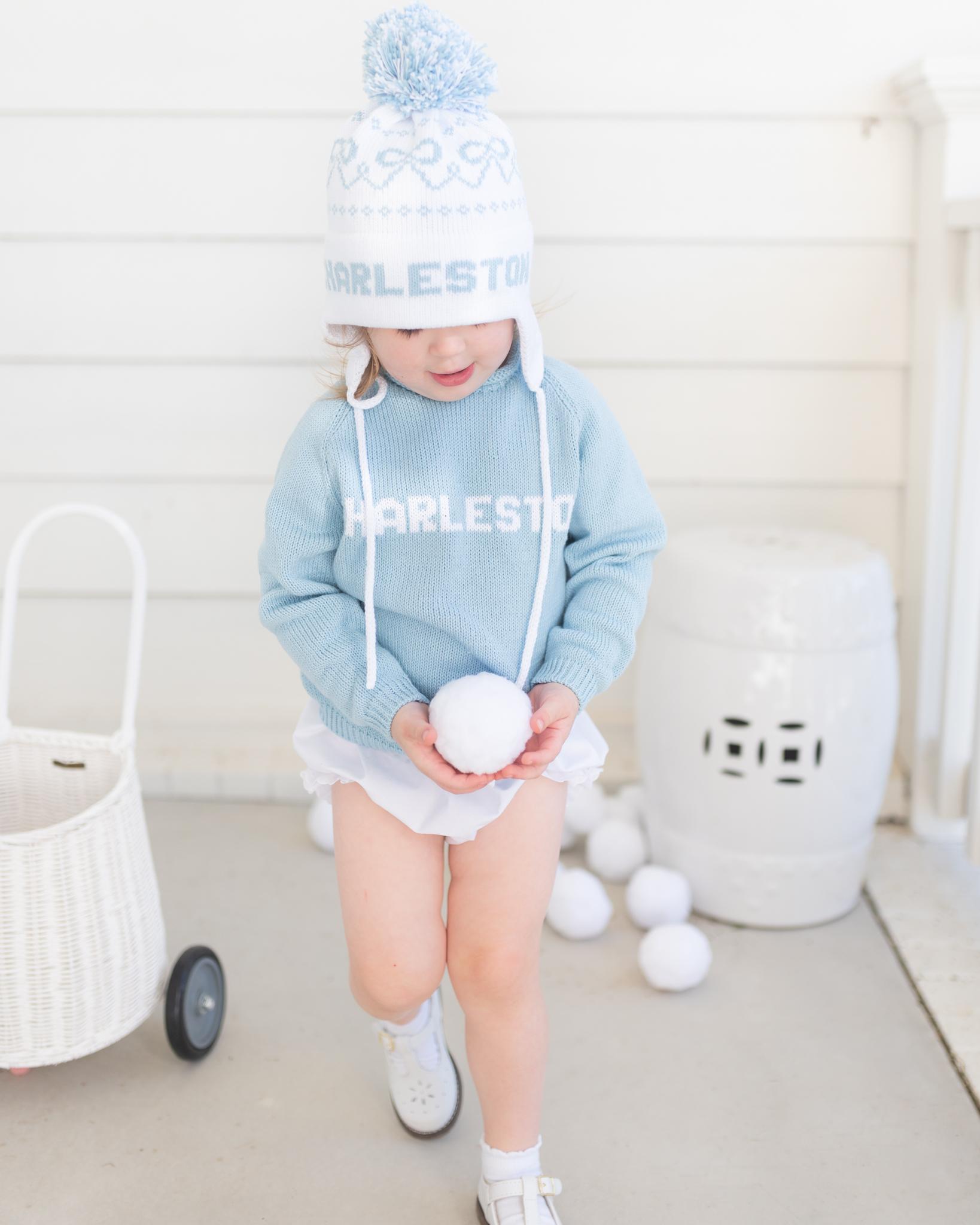 Little Girl in Hat & Sweater